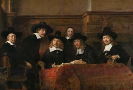 Rembrandt_-_De_Staalmeesters-_het_college_van_staalmeesters_(waardijns)_van_het_Amsterdamse_lakenbereidersgilde_-_Google_Art_Project