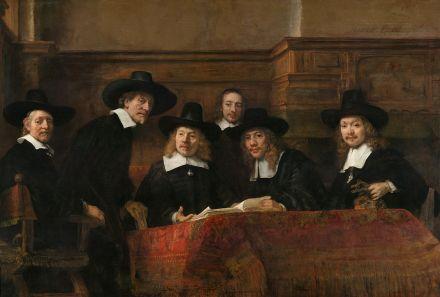 1200px-Rembrandt_-_De_Staalmeesters-_het_college_van_staalmeesters_(waar...[1]